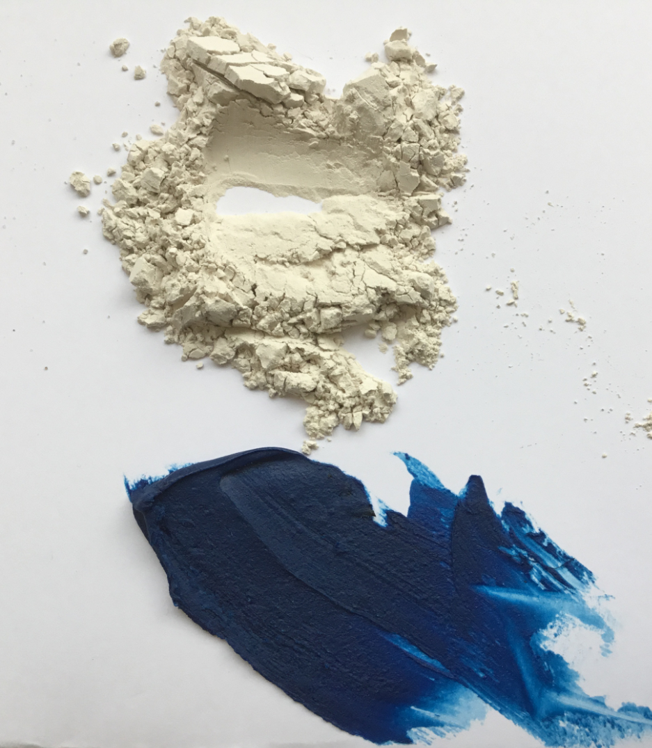 limestone with blue oil paint and cold wax